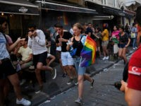 People run to avoid the effects of tear ga , fired by police to disperse activists on a street in central Istanbul, after a Pride march event was banned by authorities, in Istanbul, Sunday, June 30, 2019. Activists gathered in Istanbul to promote rights for gay and transgender people Sunday …