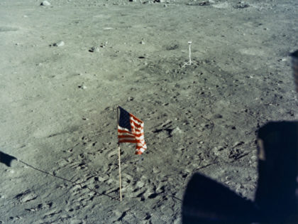 The United States flag is planted on the surface of the Moon by the astronauts of NASA's Apollo 11 lunar landing mission, as seen from inside the Lunar Module the 'Eagle', 20th July 1969. In the background is the black and white lunar surface television camera which televised astronauts Neil …