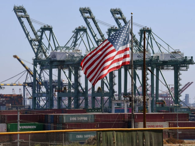 "The US flag flies over Chinese shipping containers that were unloaded at the Port of Long Beach, in Los Angeles County, on September 29, 2018. - President Donald Trump insisted that there had been ""absolutely no impact"" on the US economy from the escalating trade dispute between his administration and …"