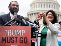 US Representative Rashida Tlaib (R), Democrat of Michigan, and US Representative Al Green, Democrat of Texas, hold a computer flash drive during a press conference at the US Capitol in Washington, DC, May 9, 2019. - The drive contains 10 million signatures on a petition urging the US Congress to …