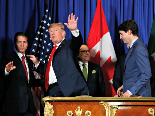President Donald Trump, Canada's Prime Minister Justin Trudeau, right, and Mexico's President Enrique Pena Nieto, left, walk out after participating in the USMCA signing ceremony, Friday, Nov. 30, 2018 in Buenos Aires, Argentina. (AP Photo/Pablo Martinez Monsivais)