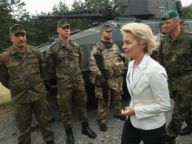 NEUSTADT AM RUEBENBERGE , GERMANY - JUNE 29: German Defense Minister Ursula von der Leyen chats with soldiers of the Bundeswehr, the German armed forces, following a demonstration of capabilities of Panzergranadierbataillon 33 of the 1st Panzer Division (1. Panzerdivision) that included the new Puma infantry fighting vehicle on June …