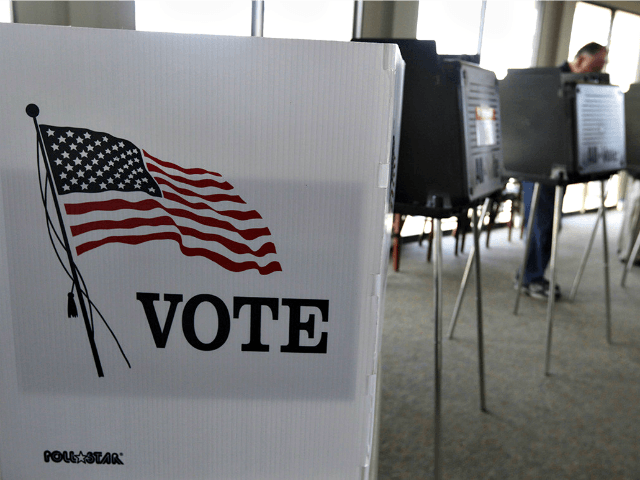In general elections, roughly 4 in 10 voters cast their ballots in ways other than in person on Election Day, making them unreachable by interviewers positioned outside polling places. | M. Spencer Green, File/AP Photo