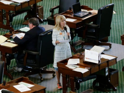 Sen. Wendy Davis, D-Fort Worth, stands on a near empty senate floor as she filibusters in an effort to kill an abortion bill, Tuesday, June 25, 2013, in Austin, Texas. The bill would ban abortion after 20 weeks of pregnancy and force many clinics that perform the procedure to upgrade …