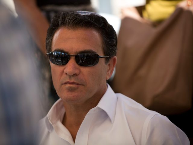 In this Sunday, July 3, 2016. photo, Yossi Cohen, director of Mossad, Israel's state intelligence agency, attends the funeral of Miki Mark who was killed in an shooting attack in the West Bank Friday, in Jerusalem. Mark was killed by Palestinian gunman while driving his family near Hebron. His wife …
