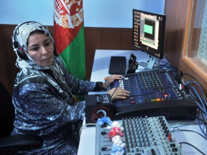 "An Afghan female journalist works in the studio of ""Shahrzad"", the second woman's radio station to be dedicated to the interests of women in Herat on October 14, 2012. 'Shahrzad', which beams out to Herat city and surrounding districts, promises to help women deal with the violence and discrimination they …"