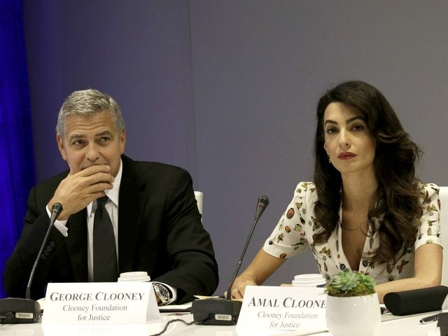 NEW YORK, NY - SEPTEMBER 20: (AFP OUT) Actor George Clooney (L) and wife Amal Clooney attend a Leaders Summit for Refugees during the United Nations 71st session of the General Debate at the United Nations General Assembly on September 20, 2016 in New York, New York. (Photo by Peter …
