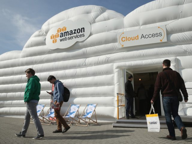 HANOVER, GERMANY - MARCH 14: Visitors arrive at the cloud pavillion of Amazon Web Services at the 2016 CeBIT digital technology trade fair on the fair's opening day on March 14, 2016 in Hanover, Germany. The 2016 CeBIT will run from March 14-18. (Photo by Sean Gallup/Getty Images)