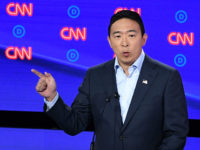 Democratic presidential hopeful US Senator from California Kamala Harris looks on as US entrepreneur Andrew Yang speaks during the second round of the second Democratic primary debate of the 2020 presidential campaign season hosted by CNN at the Fox Theatre in Detroit, Michigan on July 31, 2019. (Photo by Jim …