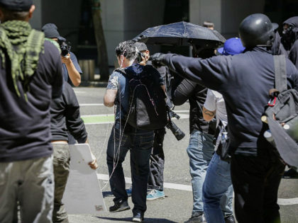 PORTLAND, OR - JUNE 29: Andy Ngo, a Portland-based journalist, is seen covered in an unknown substance after unidentified Rose City Antifa members attacked him on June 29, 2019 in Portland, Oregon. Several groups from the left and right clashed after competing demonstrations at Pioneer Square, Chapman Square, and Waterfront …