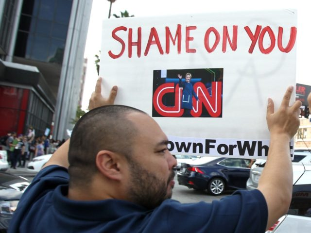 Bernie's supporters protest against the lack of Sanders coverage in front of the CNN building in Los Angeles, California, on April 3, 2016. / AFP / TOMMASO BODDI (Photo credit should read TOMMASO BODDI/AFP/Getty Images)