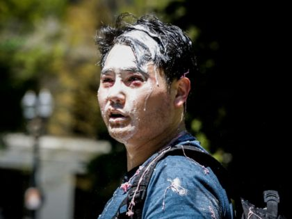 PORTLAND, OR - JUNE 29: Andy Ngo, a Portland-based journalist, is seen covered in unknown substance after unidentified Rose City Antifa members attacked him on June 29, 2019 in Portland, Oregon. Several groups from the left and right clashed after competing demonstrations at Pioneer Square, Chapman Square, and Waterfront Park …