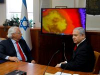 Israeli Prime Minister Benjamin Netanyahu (R) and US Ambassador to Israel David Friedman watch a video which shows the launch of the Arrow 3 hypersonic anti-ballistic missile during a cabinet meeting in Jerusalem on July 28 2019. (Photo by MENAHEM KAHANA / POOL / AFP) (Photo credit should read MENAHEM …