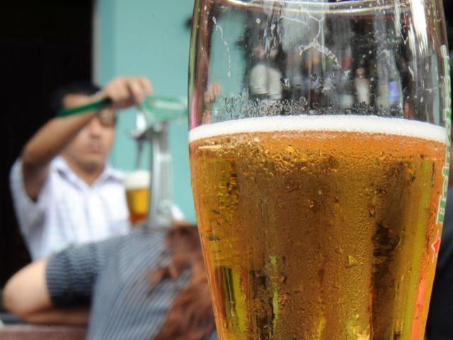TO GO WITH Malaysia-religion-caning-Islam-tourism FEATURE by Beh Lih Yi This photo taken on July 20, 2010 shows a bar-tender filling a glass with beer for a customer in Kuala Lumpur's vibrant Bukit Bintang nightlife district. Malays, who make up 60 percent of the population, are forbidden to have sex out …