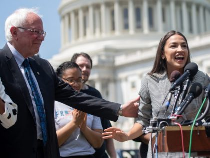 Representative Alexandria Ocasio-Cortez (2nd R), Democrat of New York, speaks alongside US Senator Bernie Sanders (2nd L), Independent of Vermont, and Representative Ilhan Omar (L), Democrat of Minnesota, during a press conference to introduce college affordability legislation outside the US Capitol in Washington, DC, June 24, 2019. (Photo by SAUL …
