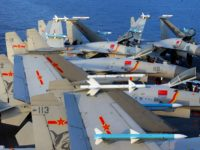 "This undated photo taken in April 2018 shows J15 fighter jets on China's sole operational aircraft carrier, the Liaoning, during a drill at sea. - A flotilla of Chinese naval vessels held a ""live combat drill"" in the East China Sea, state media reported early April 23, 2018, the latest …"