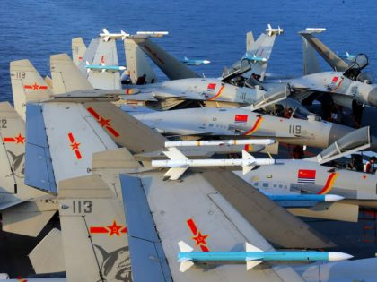 """This undated photo taken in April 2018 shows J15 fighter jets on China's sole operational aircraft carrier, the Liaoning, during a drill at sea. - A flotilla of Chinese naval vessels held a """"live combat drill"""" in the East China Sea, state media reported early April 23, 2018, the latest …"""