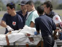 Costa Rican Red Cross workers attend to one of the burn victims from a chemical plant fire, as he arrives by air ambulance at the Juan Santamaria International Airport near Alajuela , Costa Rica, Wednesday, Dec. 13, 2006. Three people were killed and three people were transported by air ambulance …