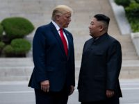 TOPSHOT - US President Donald Trump and North Korea's leader Kim Jong-un stand on North Korean soil while walking to South Korea in the Demilitarized Zone(DMZ) on June 30, 2019, in Panmunjom, Korea. (Photo by Brendan Smialowski / AFP) (Photo credit should read BRENDAN SMIALOWSKI/AFP/Getty Images)