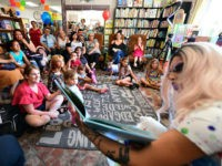 Drag queen Scalene Onixxx reads to adults and children during Drag Queen Story Hour at Cellar Door Books in Riverside, California on June 22, 2019. - Athena and Scalene, their long blonde hair flowing down to their sequined leotards and rainbow dresses, are reading to around 15 children at a …