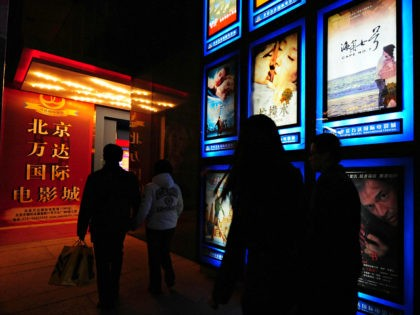 "Moviegoers make their way to a multiplex cinema in Beijing on February 14, 2009, where Taiwanese film ""Cape No. 7"", as advertised on top right, hit movie screens in China with its opening. The Taiwanese blockbuster finally hit movie screens in China after a two-month delay widely believed linked to …"