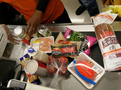 In this April 23, 2012, file photo Philadelphia Mayor Michael Nutter's purchases are scanned by a cashier at a ShopRite grocery story in Philadelphia after Nutter pledged to live on the average food stamp benefit of five dollars a day for the entire week. Food stamps look ripe for the …