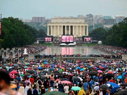 """Crowds are massed around the Reflecting Pool as US President Donald Trump speaks during the """"Salute to America"""" Fourth of July event at the Lincoln Memorial in Washington, DC, July 4, 2019. (Photo by ANDREW CABALLERO-REYNOLDS / AFP) (Photo credit should read ANDREW CABALLERO-REYNOLDS/AFP/Getty Images)"""