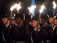 German soldiers stand to attention during a torchlit procession to bid farewell to NATO Supreme Allied Commander Europe (SACEUR) US Admiral James Stavridis at the defence ministry in Berlin April 17, 2013. AFP PHOTO / JOHN MACDOUGALL (Photo credit should read JOHN MACDOUGALL/AFP/Getty Images)