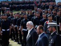 Gaza's Hamas Prime Minister Ismail Haniyeh, center, and Fathi Hamad, Gaza's Hamas interior minister, second right, review honor guards during a graduation ceremony of Hamas security officers in the northern Gaza Strip, Wednesday, April 2, 2014. 1200 officers graduated from advanced training courses that lasted one year in Gaza police …