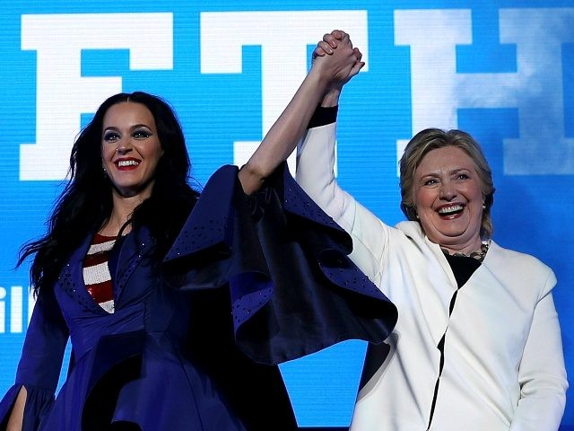 PHILADELPHIA, PA - NOVEMBER 05: Democratic presidential nominee former Secretary of State Hillary Clinton (R) raises her arms with recording artist Katy Perry (L) during a get-out-the-vote concert at the Mann Center for the Performing Arts on November 5, 2016 in Philadelphia, Pennsylvania. With three days to go until election …