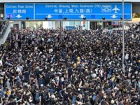 TOPSHOT - Protesters gather on roads outside the government headquarters in Hong Kong on July 1, 2019, on the 22nd anniversary of the city's handover from Britain to China. - Anti-government protesters trying to ram their way into Hong Kong's parliament battled police armed with pepper spray on July 1 …