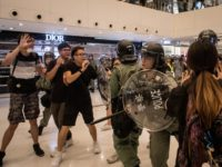 HONG KONG, HONG KONG - JULY 14: Riot police chase protesters through a shopping mall as they clash with protesters after taking part in a pro-democracy march on July 14, 2019 in Hong Kong, China. Thousands of protesters marched in Sha Tin district on Sunday as pro-democracy demonstrators continued weekly …