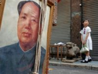 A schoolgirl stands on the pavement in front of a portrait of China's revolutionary leader Mao Tse-tung in Hong Kong, 05 September 2006. September 09 will marks the 30th anniversary of the death of Mao Tse-tung, responsible for the 1966-1976 Cultural Revolution in China. AFP PHOTO/Philippe LOPEZ (Photo credit should …