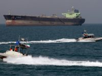 Iranian Revolutionary Guard speedboats cruise past an oil tanker off the port of Bandar Abbas, southern Iran, on July 2, 2012. Iran has come up with several methods to foil the European insurance embargo on ships loaded with its crude, a sanction which may harm its vital exports as much …