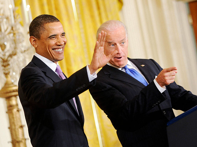 WASHINGTON - JANUARY 21: (AFP OUT) President Barack Obama and Vice President Joe Biden greet the delegation from the U.S. Conference of Mayors in the East Room on January 21, 2010 in Washington, DC. The President and Vice President spoke on building up the economy and producing more jobs in …