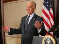 Former Democratic presidential candidate Delaware Senator Joe Biden (L) gestures after being asked to stand behind the presidential podium after US President George W. Bush signed the Second Chance Act of 2007 at the Eisenhower Executive Office Building next to the White House in Washington, DC, on April 9, 2008. …