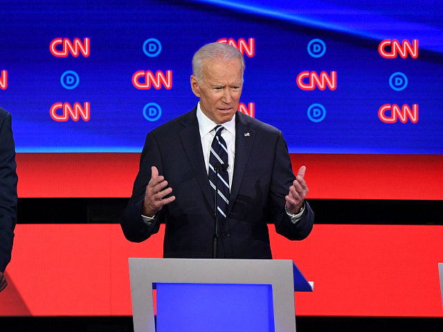 Democratic presidential hopeful Former Vice President Joe Biden (C) gestures as he speaks flanked by US Senator from California Kamala Harris (R) and US Senator from New Jersey Cory Booker during the second round of the second Democratic primary debate of the 2020 presidential campaign season hosted by CNN at …