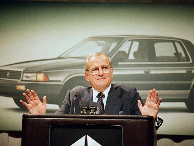 FILE - In this Feb. 2, 1989, file photo, Chrysler Corp. Chairman Lee Iacocca gestures while speaking about fourth quarter pre-tax earnings which are up 23.8 percent for the automaker at Grand Hyatt Hotel, New York. Former Chrysler CEO Iacocca, who became a folk hero for rescuing the company in …