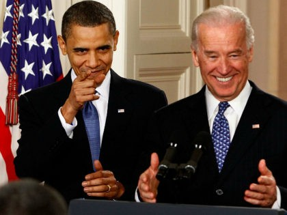 WASHINGTON - MARCH 23: U.S. President Barack Obama and Vice President Joe Biden receive a standing ovation during the signing ceremony for the Affordable Health Care for America Act in the East Room of the White House March 23, 2010 in Washington, DC. The landmark bill was passed by the …