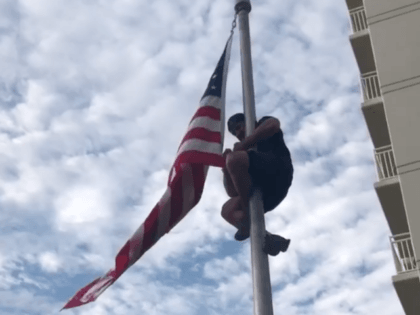 WATCH: Veteran Climbs Flag Pole to Secure Loose American Flag