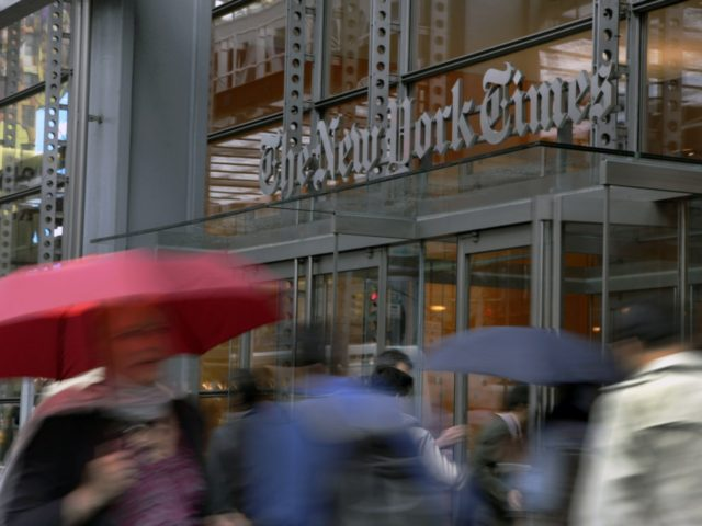 In this Wednesday, Oct. 10, 2012, photo, people pass the New York Times building in New York. The Newspaper Association of America, the New York Times Co. and several other newspaper companies have filed papers in support of a lawsuit filed by The Associated Press against Meltwater, a company that …