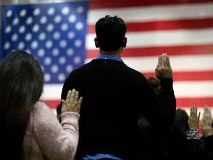 FILE - In this Feb. 15, 2017 file photo, people take the oath of citizenship during a naturalization ceremony at the Los Angeles Convention Center. In a Los Angeles ceremony Wednesday, Sept. 20, 2017, more than 9,000 new American citizens will hear a newly recorded message from President Donald Trump …