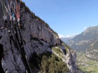 WATCH: Paraglider Crashes into Cliff, Lands Safely