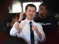 Democratic presidential hopeful and South Bend, Indiana mayor Pete Buttigieg speaks to the media beside David Gross (R) during his tour of the Vector 90 headquarters in South Central Los Angeles, California on July 25, 2019. (Photo by Mark RALSTON / AFP) (Photo credit should read MARK RALSTON/AFP/Getty Images)