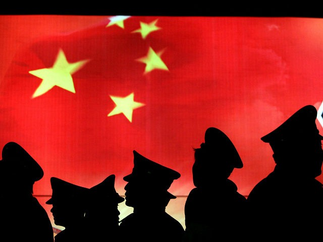 BEIJING, CHINA - MARCH 1: (CHINA OUT) Security guard walk past the Chinese national flag at the Military Museum of Chinese People's Revolution on March 1, 2008 in Beijing, China. From March 1, the Military Museum of Chinese People's Revolution becomes the first national level museum which opens to the …