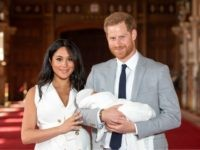 WINDSOR, ENGLAND - MAY 08: Prince Harry, Duke of Sussex and Meghan, Duchess of Sussex, pose with their newborn son Archie Harrison Mountbatten-Windsor during a photocall in St George's Hall at Windsor Castle on May 8, 2019 in Windsor, England. The Duchess of Sussex gave birth at 05:26 on Monday …