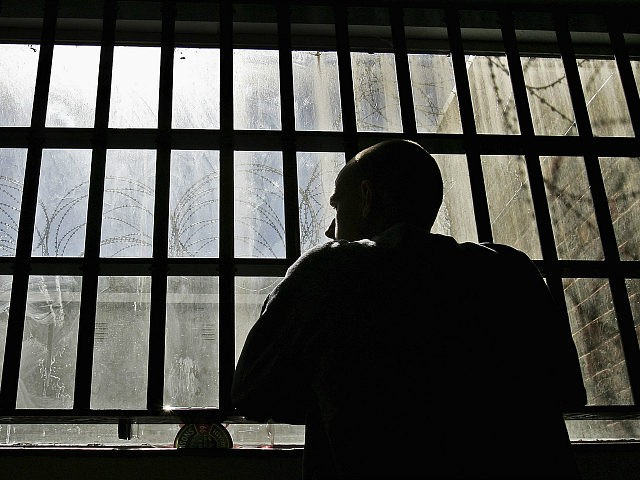 NORWICH, UNITED KINGDOM - AUGUST 25: (EDITORS NOTE: IMAGES EMBARGOED FOR PUBLICATION UNTIL 0001GMT AUGUST 26, 2005) 19 year old inmate James looks out of the window of the Young Offenders Institution attached to Norwich Prison on August 25, 2005 in Norwich, England. A Chief Inspector of Prisons report on …