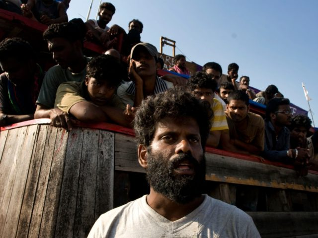 MERAK, JAVA, INDONESIA - OCTOBER 16: Sri Lankan asylum seekers engage in a hunger strike after their boat broke down on the way to Australia's Christmas Island, at Cilegon on October 16, 2009 in Merak, Java, Indonesia. Around 260 asylum seekers set off from Malaysia on a large cargo boat …