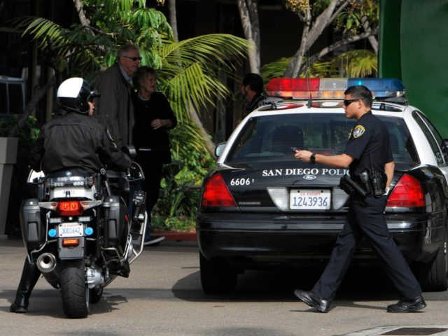 SAN DIEGO - FEBRUARY 7: Police search for suspect, former LAPD officer Christopher Jordan Dorner, at a Holiday Inn February 7, 2013 in the Point Loma area of San Diego, California. A manhunt is underway for Dorner, who is suspected of shooting at police officers in the Los Angeles area. …