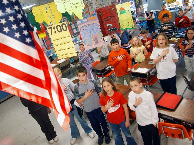 "WARMINSTER, PA - MARCH 24: Fourth graders at Longstreth Elementary School pledge allegiance to the flag March 24, 2004 in Warminster, Pennsylvania. An atheist parent, Michael Newdow, of Sacramento, California is scheduled to be heard by the Supreme Court today to defend his position that the ""Under God"" in the …"